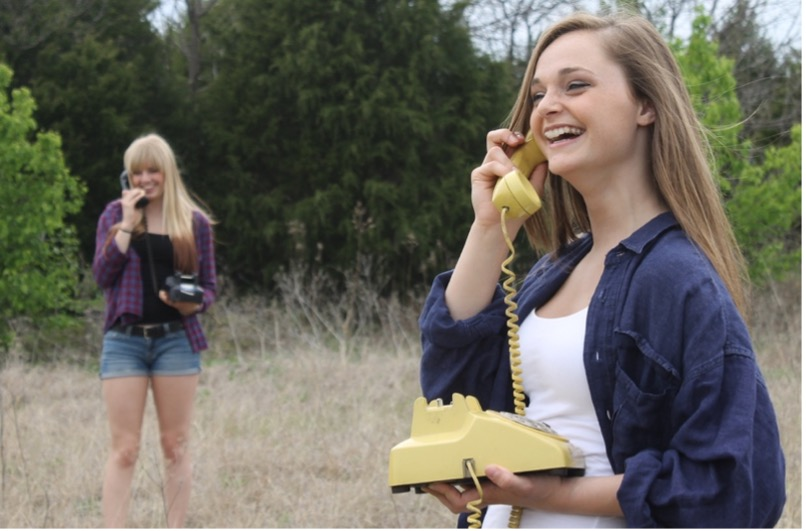 two girls talking on old fashioned phones